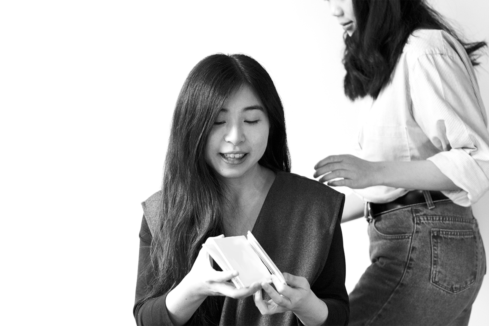 Black and white photo of Emily arranging cards
