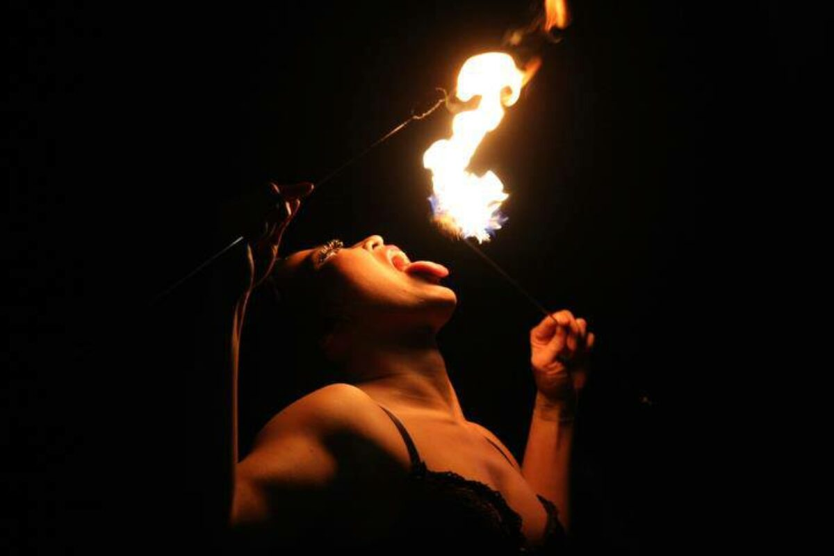 Renee performing a fire-eating act